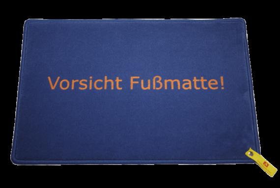Fußmatte: Vorsicht_Fussmatte_Dreckstueckchen
