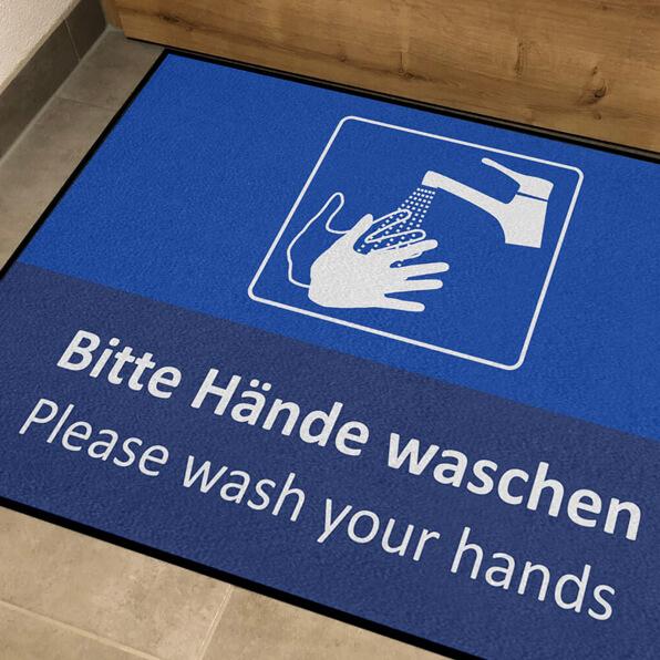 Dreckstückchen: Fußmatte Bitte Hände waschen